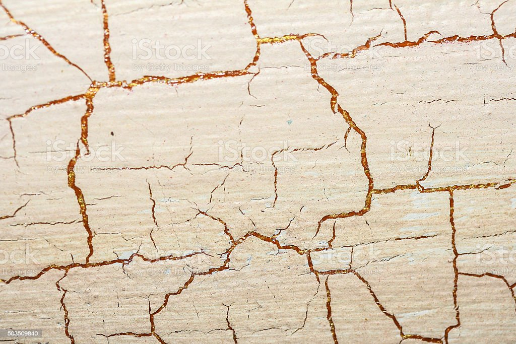 Detail of heavily cracked pink and orange paint work texture. stock photo