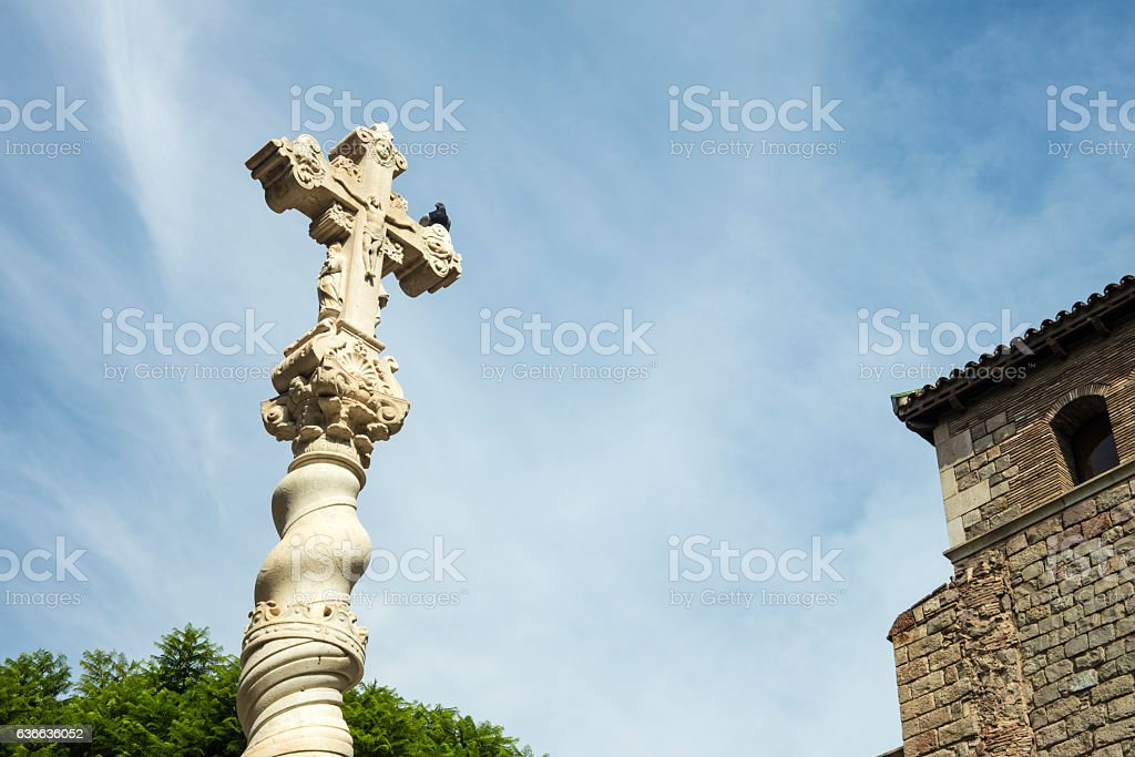 Detail of holy cross carved in stone with blue sky stock photo