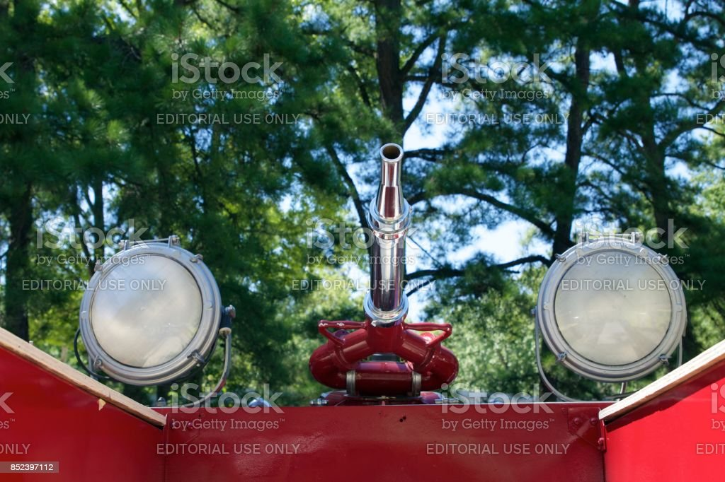 Detail of hose nozzle and search lights from a 1948 American LaFrance fire engine stock photo