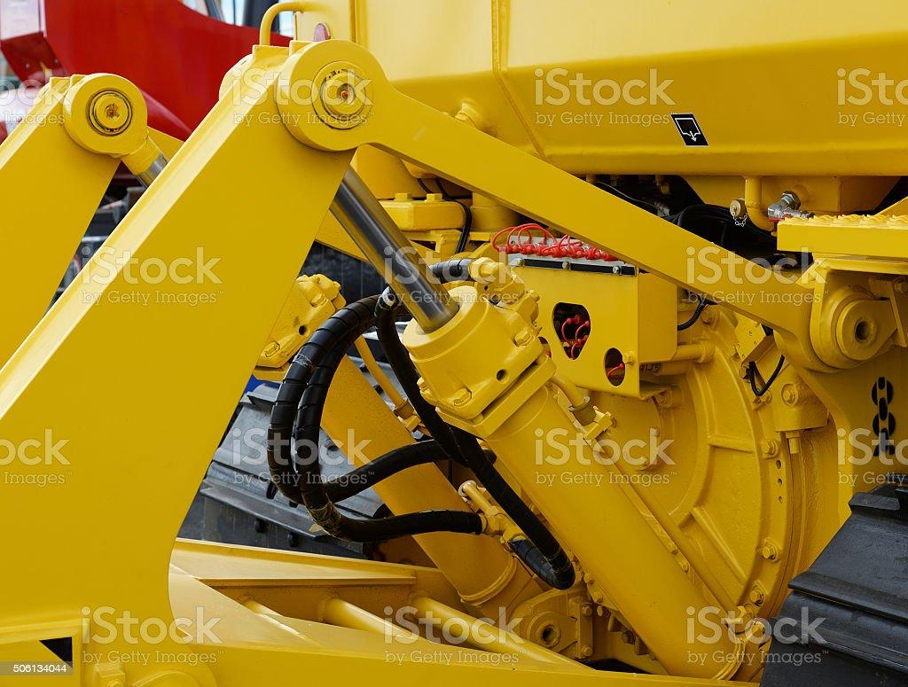 Detail of hydraulic bulldozer piston excavator stock photo
