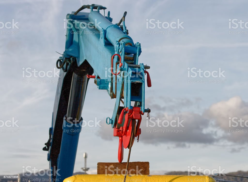 detail of hydraulic crane on a fishing vessel stock photo