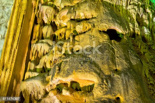 Detail of lluminated cave wall with a lot of amazing natural decorations, Homolje mountains, east Serbia