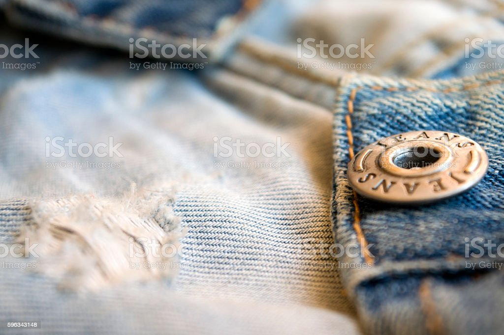 detail of jeans clothing with metal buttons royalty-free stock photo