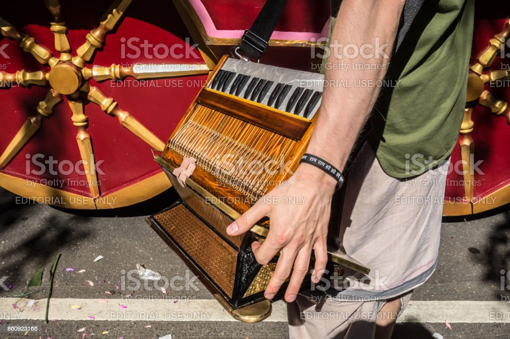 A detail of Krishna's chariot and a musician with an Indian musical instrument. stock photo