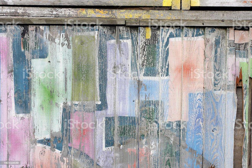 Pastel airbrushing graffiti on wooden fence stock photo