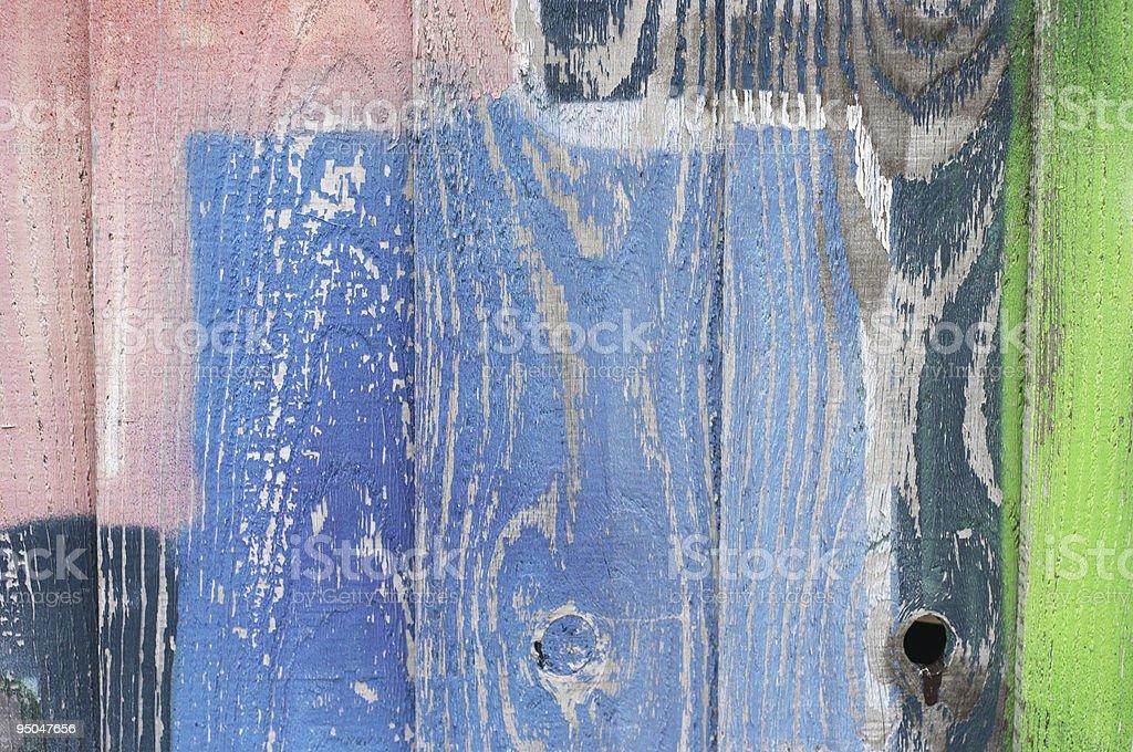 Pastel airbrushing on wooden fence stock photo