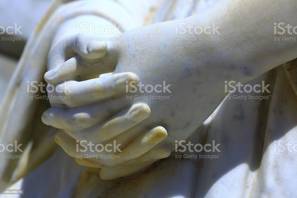 Detail of marble Virgin Mary praying hands stock photo
