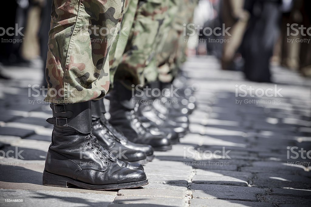 Detail of marching soldiers featuring their boots stock photo