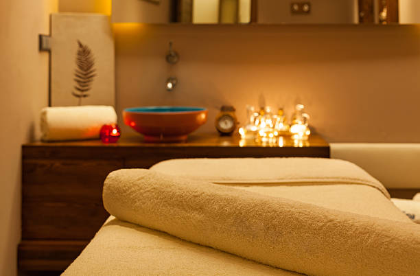 detail of massage room. focus on towel - spa treatment stock photos and pictures