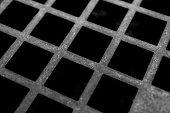 Detail of mesh of a brass sieve