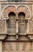 Ancient door in the facade of Mezquita in Cordoba, Spain