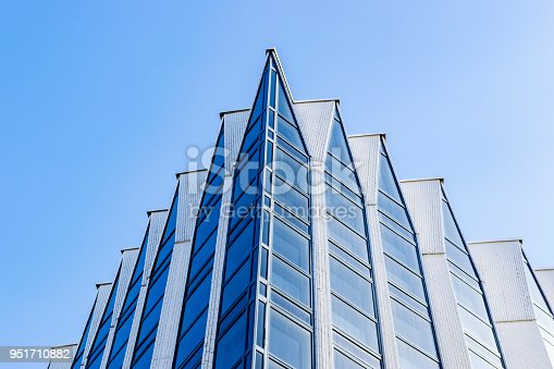 Detail of modern office building exterior. Business buildings skyline looking up with blue sky. Modern architecture. Modern apartmen. High tech exterior. Reflective office buildings. Office Skyscrapper. Glass office.