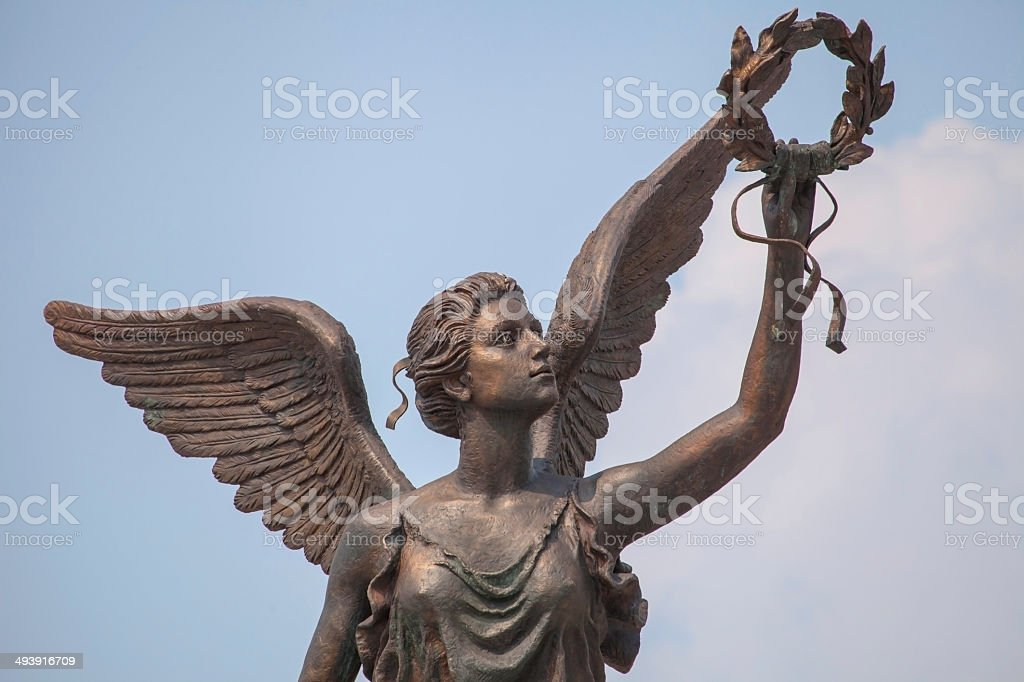 Detail of monument to goddess of victory Nike against the sky. stock photo