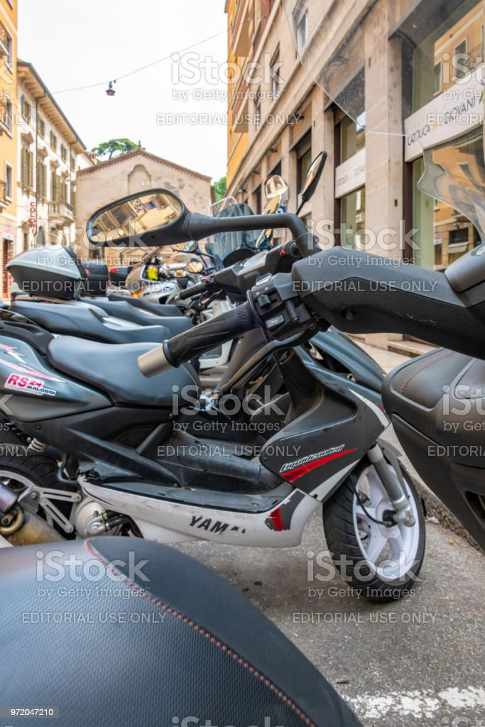 Detail of mopeds parked in Verona, Italy stock photo