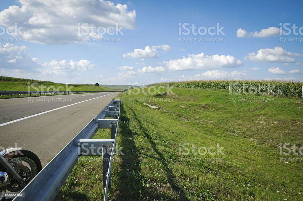 Detail of Motorbike on the Road royalty-free stock photo