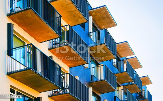 493502515 istock photo Detail of new apartment residential building with balconies reflex 1195568376