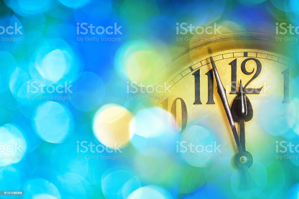 Detail of new year clock with blue background stock photo