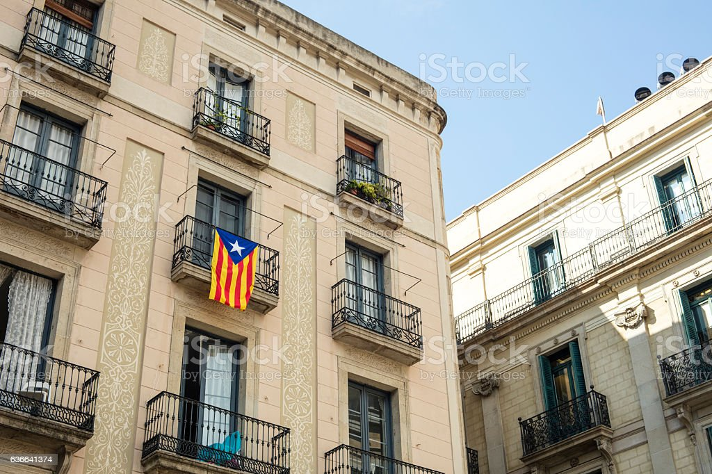 Detail of old building and a independentist catalan flag stock photo