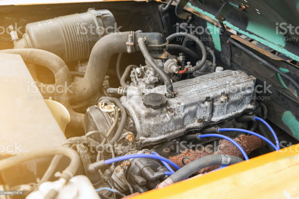 detail of old forklift engine in the garage stock photo