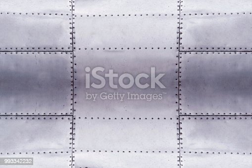 detail of old grunge piece of metal plate with bolts, aluminium surface background