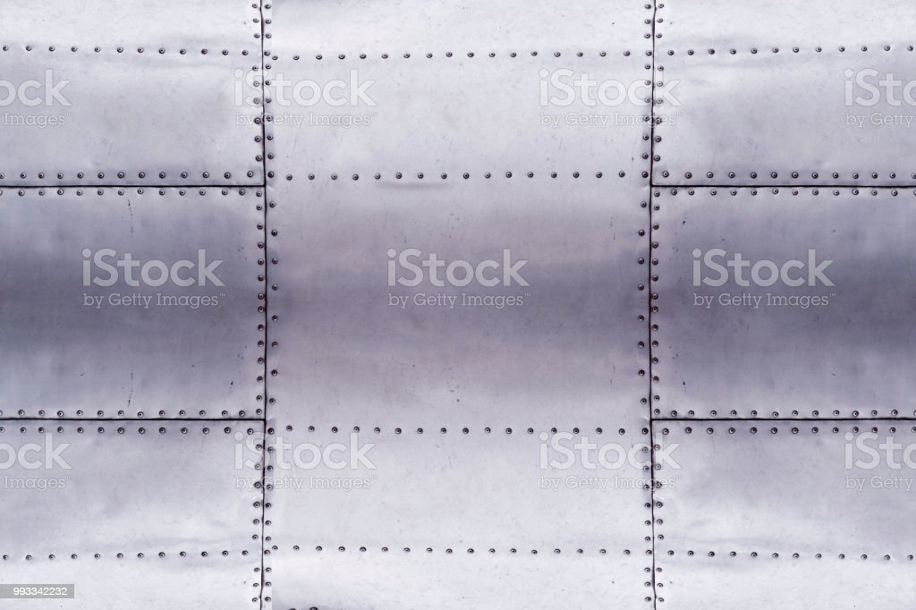 detail of old grunge piece of metal plate with bolts, aluminium surface background stock photo