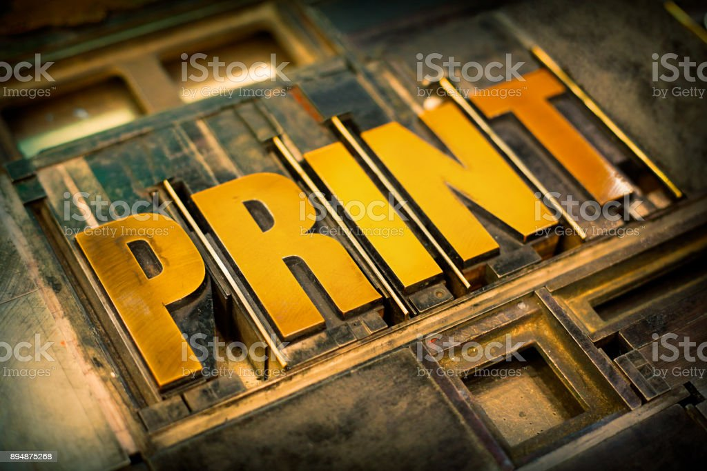 Detail of old printing plate with print letters stock photo