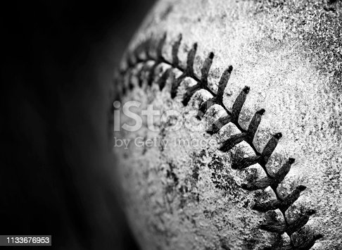 Detail of old worn baseball with leather texture game sports competition