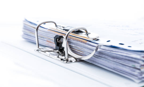 Detail of open folder filled with documents. Symbol of business or bureaucracy stock photo