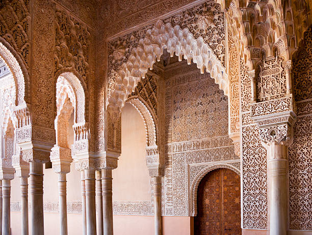 Detail of Ornate Decoration at Alhambra Palace in Granada, Spain Detail of ornate decoration at Alhambra Palace in Granada, Spain. This photograph was taken at the entrance to Patio de los Leones (Court Of The Lions). palacios nazaries stock pictures, royalty-free photos & images