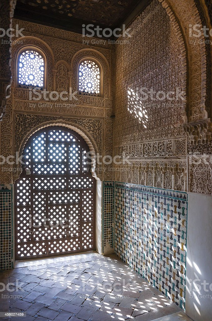Detail of Ornate Wall Decoration at Alhambra Palace in Granada stock photo