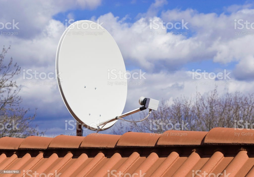 Detail of parabola on the red roof stock photo