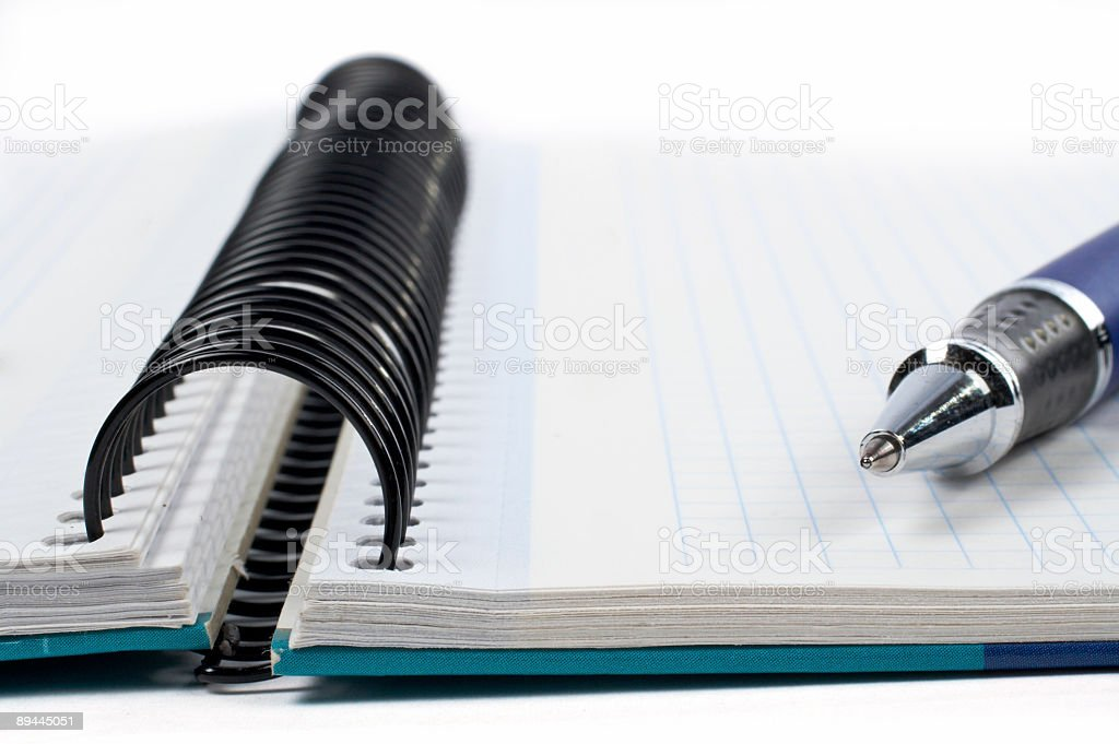 Detail of pen and blank notebook sheet royalty-free stock photo
