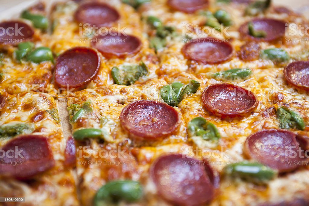 Detail of Pepperoni and Green Pepper Pizza royalty-free stock photo
