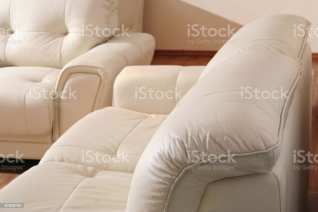 Detail of piping on white leather sofa royalty-free stock photo