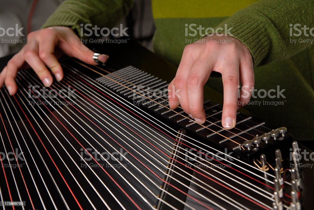 Detail of playing on zither musical instrument stock photo