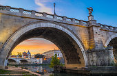 Detail of Ponte Sant'Angelo with the Tiber river in Rome at sunset