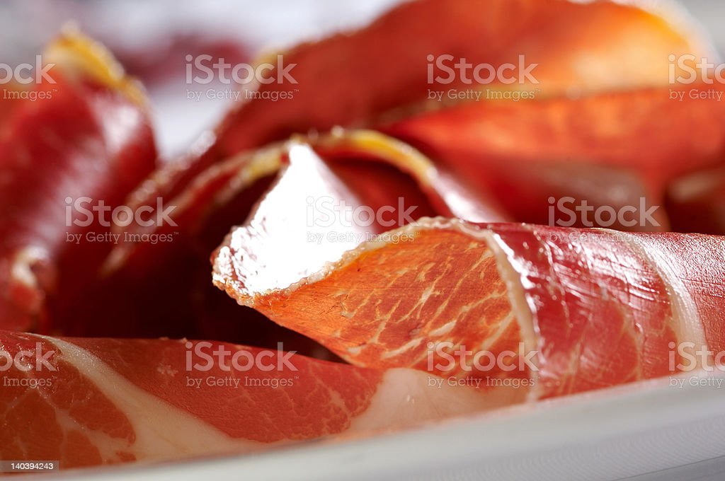 Detail of prosciutto stock photo