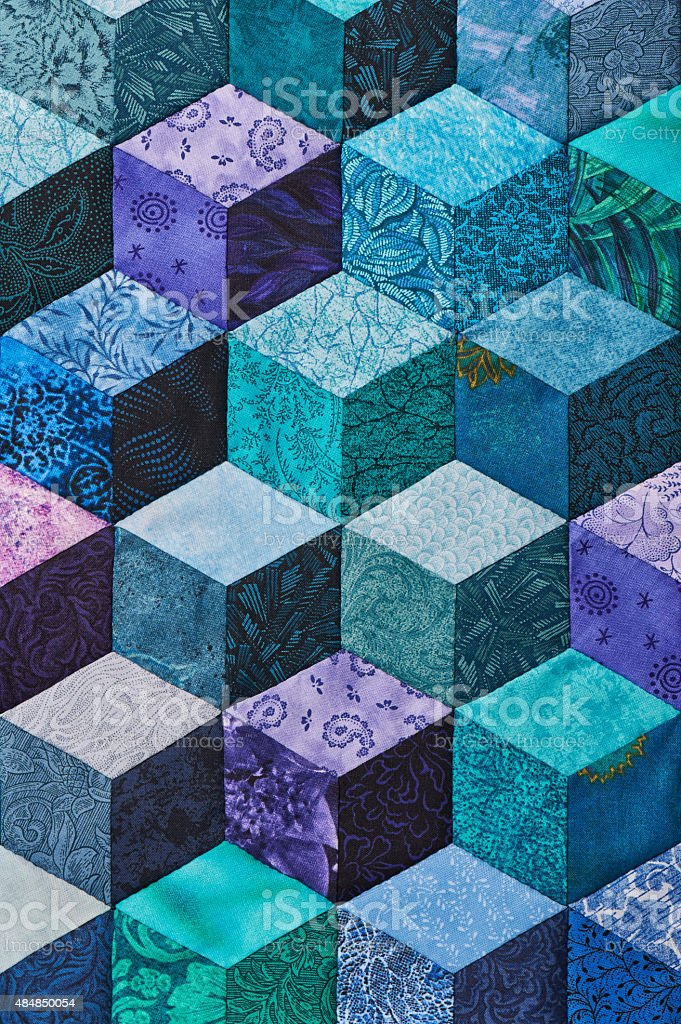 Detail of quilt sewn from rhombuses stock photo