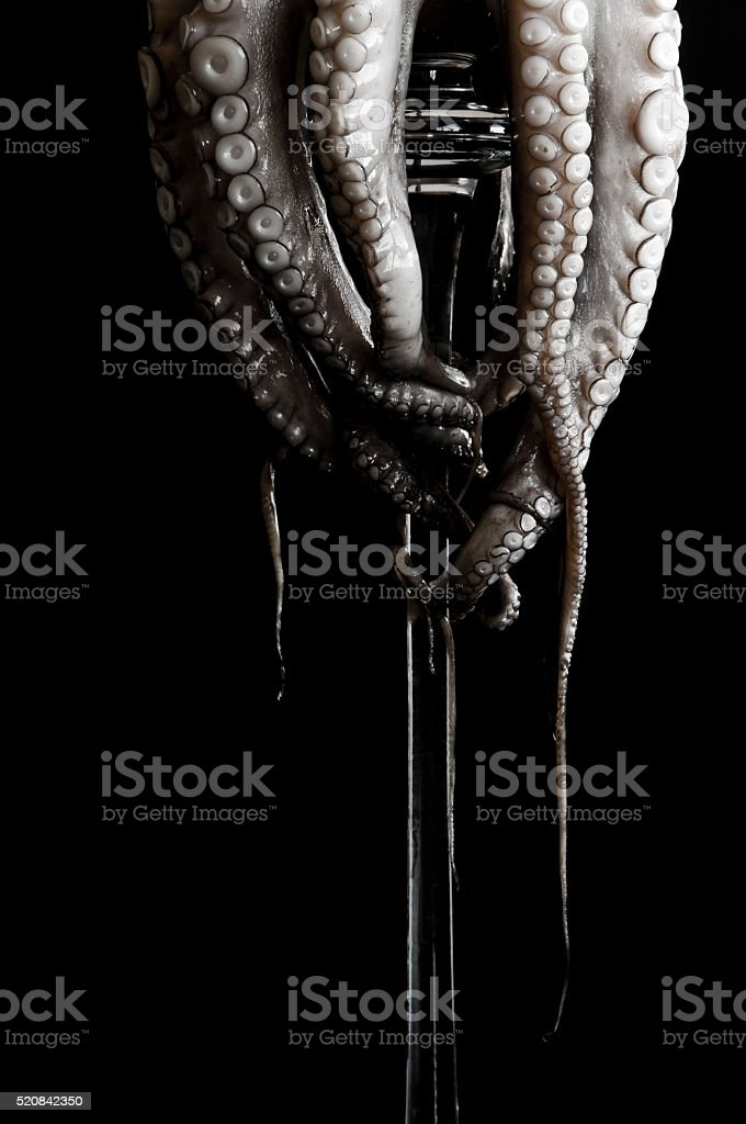 detail of raw octopus on a glass pedestal stock photo