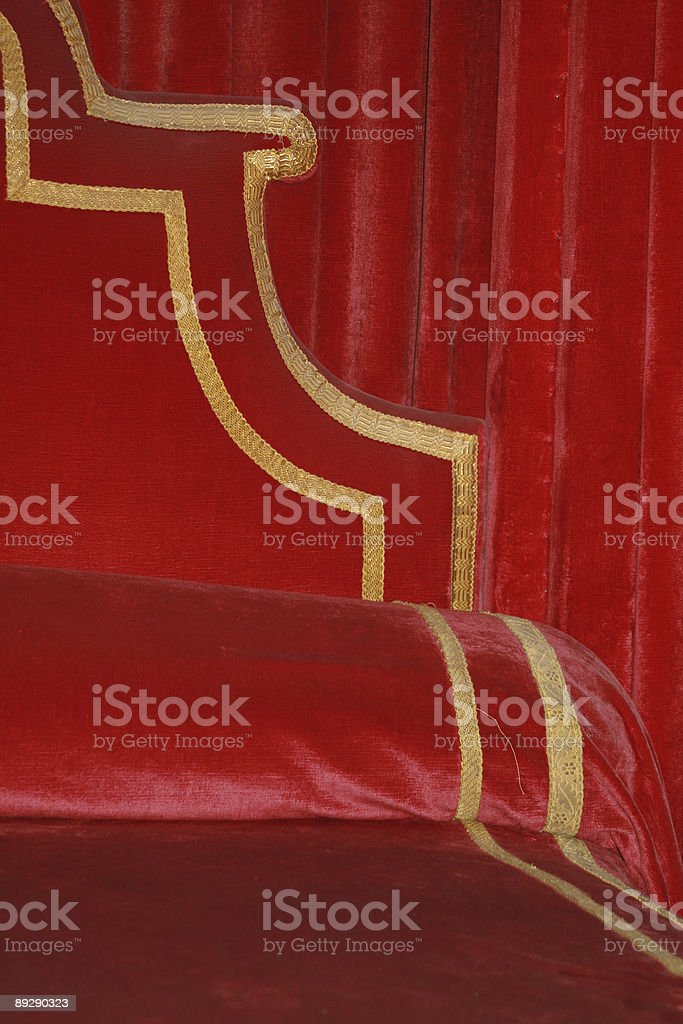 detail of red kings bed stock photo