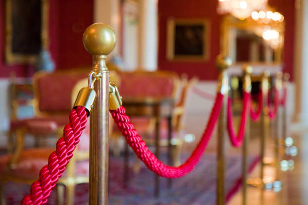 Detail of red rope on a exhibition space - defocused background concept image stock photo