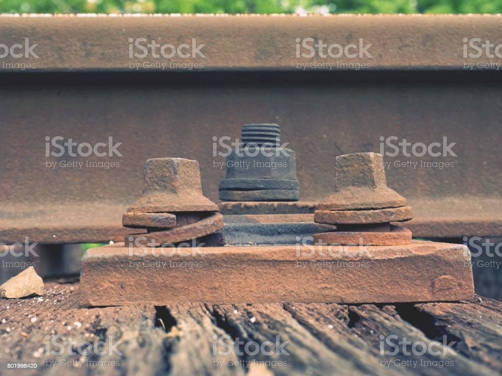 Detail Of Rusty Screws And Nut On Old Railroad Track Rooten