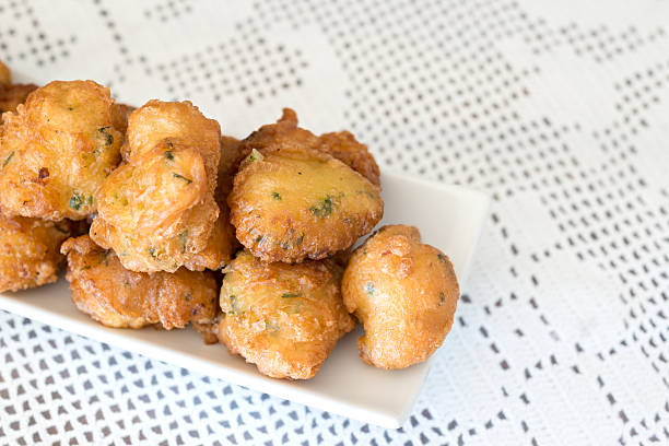Detail of some cod fritters Detail of a homemade cod fritters fritter stock pictures, royalty-free photos & images