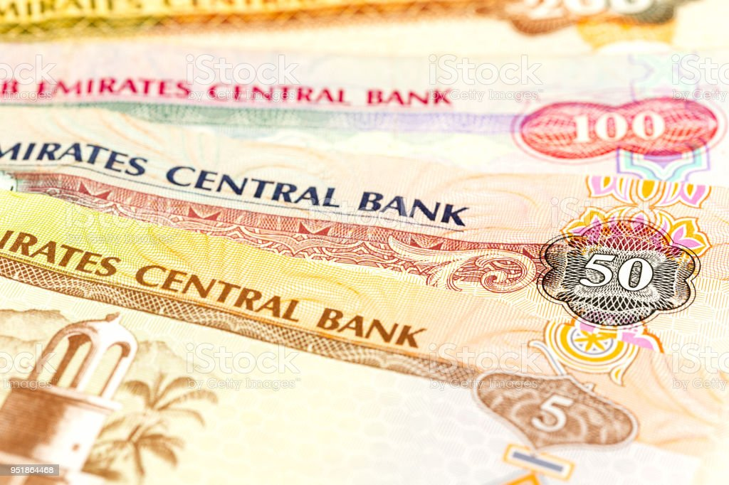 detail of some united arab emirates dirham bank notes stock photo