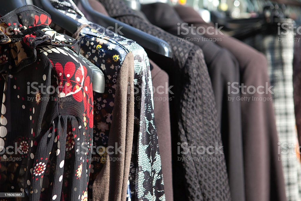 Detail of some vintage dresses at a market stall; DOF stock photo