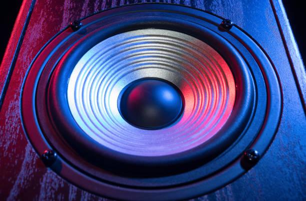 Detail of sound speaker in neon light. stock photo