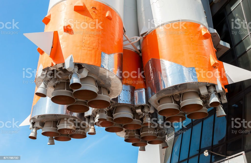 Detail of space rocket engine against the blue sky background stock photo