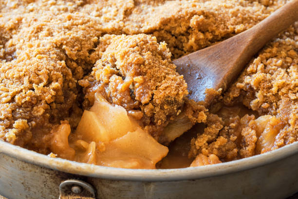 Detail of Spoonful of Apple Crisp or Apple Crumble Baked Dessert stock photo