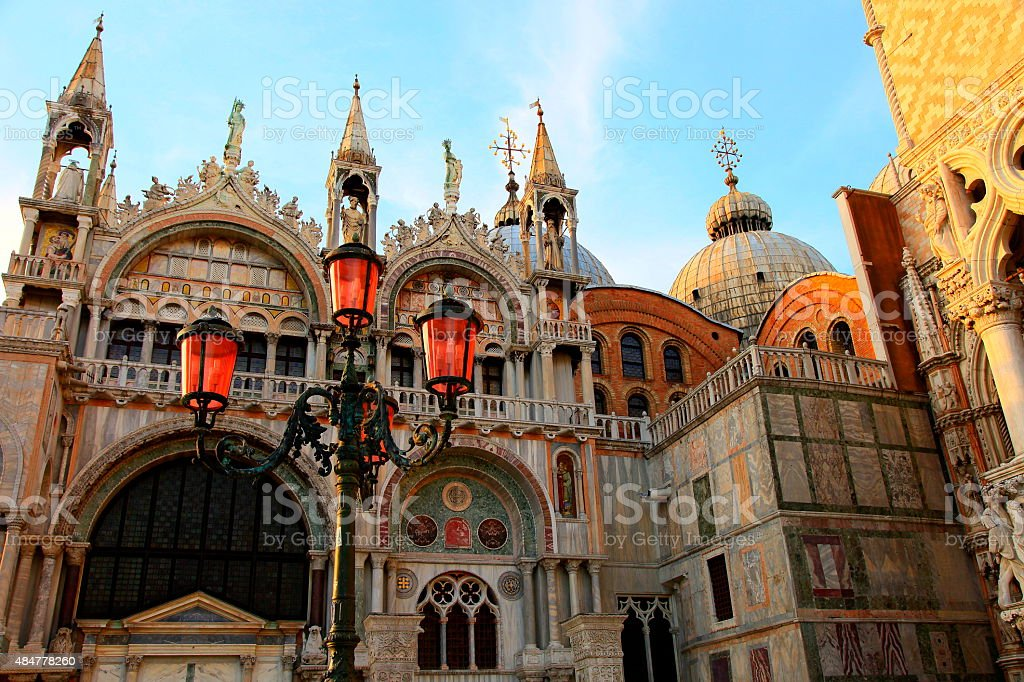 Detail of St. Marks Cathedral marble frescos, lamp, Venice, Italy stock photo