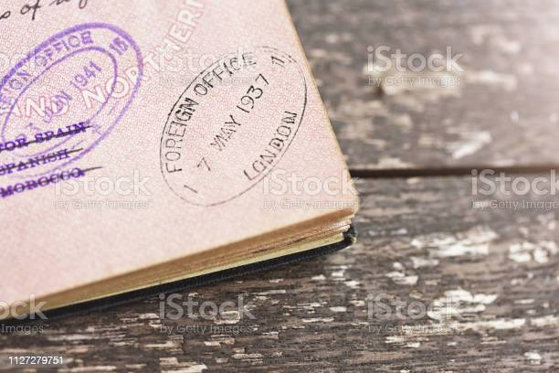 Detail of stamps in a 1937 vintage british passport picture id1127279751?b=1&k=6&m=1127279751&s=612x612&h=cng5hwkbvvu71wspddovs3bnbwf8lj08w7b phbg5tc=